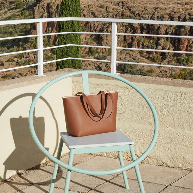 Our new Small Structured Tote, a petite version of our beloved classic, has equally ample storage space. Pair it with one of our adjustable straps for added versatility, and you're ready to go.