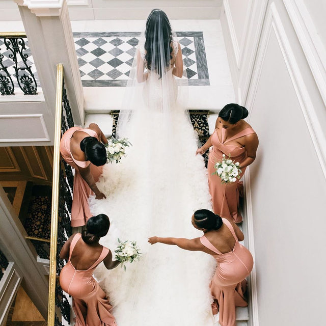 Good bridesmaids always have your back. 👯💕 Head to the #linkinbio for a dreamy wedding that included an intimate garden ceremony with sun-worn statues and rolling hills and a reception full of oil paintings, frescoes, and gilded accents. ✨✨ #WeddingOfTheDay | 📸: @lisapoggi 📋: @exclusiveitalyweddings 💐: @stiatti_fiori_