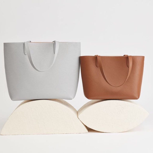 We're expanding our tote collection. Featuring our Small Structured Tote and Classic Structured Tote in a brand new textured leather—two pieces designed to complete your fall wardrobe. Link in bio.