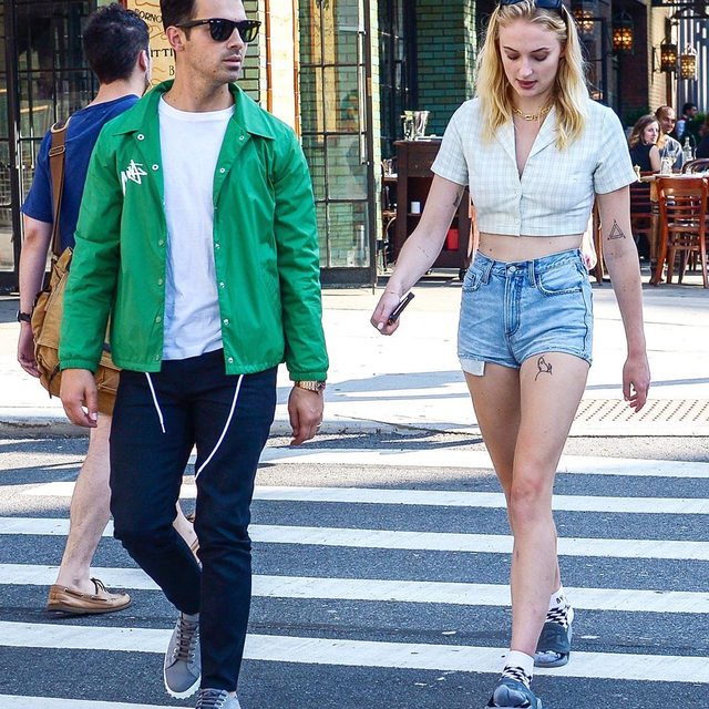 Leave it to @sophiet to make socks and sandals look chill and effortless. Tap our link in bio if you're trying to recreate her off-duty summer vibe. photo: splash news