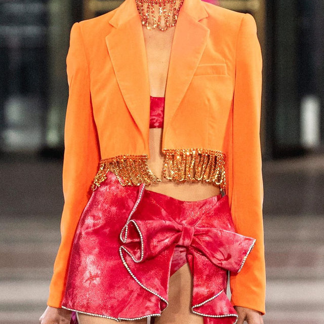 Cutest couple of the season: orange & pink. The bold color combination was all over the F/W '19 runways and we're ready to start wearing it now. Tap our link for the pieces to get you going with the trend. photos: getty images