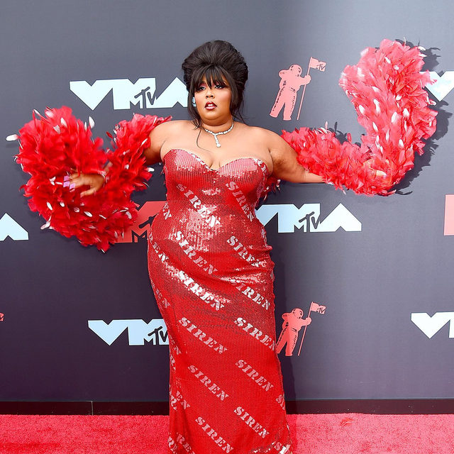 I just took a DNA test turns out I'm 100% obsessed with @lizzobeeating in @moschino at the #VMAs. photo: getty images