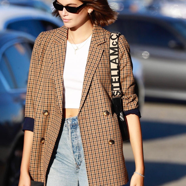 A plaid blazer, white tee, loose-fit jeans—that's all the early fall outfit inspiration we need. Tap the link in bio to get @kaiagerber's perfectly effortless look. photo: backgrid