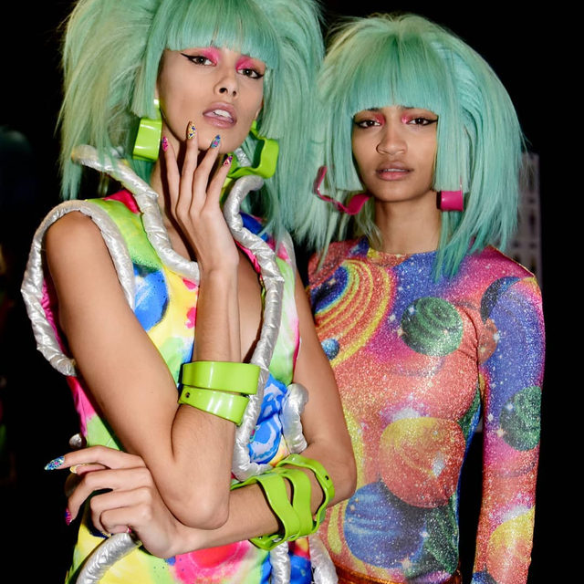 Last night @JeremyScott was on the opening ballot of shows at #NYFW, turning up the volume with streams of neon-coloured glam metal wigs by @EugeneSouleiman, orbital lamé cocktail dresses and planetary print jumpsuits. Click the link in bio to see every look from the intergalactic, sci-fi rock band influenced #SS20 show.