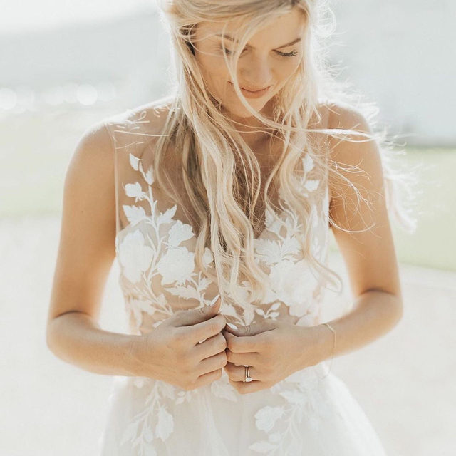 Sunswept hair + California sun on this beautiful #BHLDNBride, @caityjean. (Tap to shop the Valera Gown | 📷: @kayleechelseaphotography)