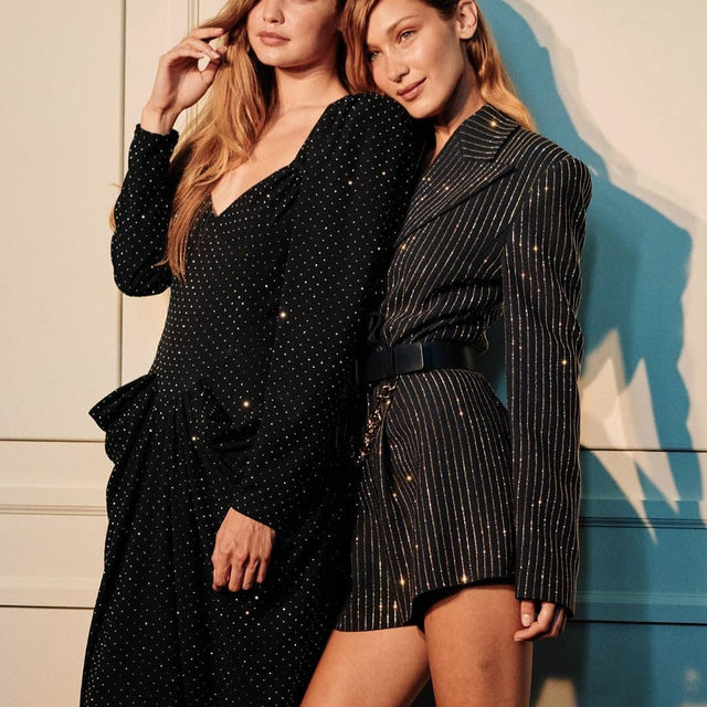 Sisters #GigiHadid and #BellaHadid shimmer backstage at @MichaelKors's show at #NYFW. Nipped-in waists and strong shoulders ruled in a '40s-inspired collection imbued with patriotism. Click the link in bio to see every look from the show.