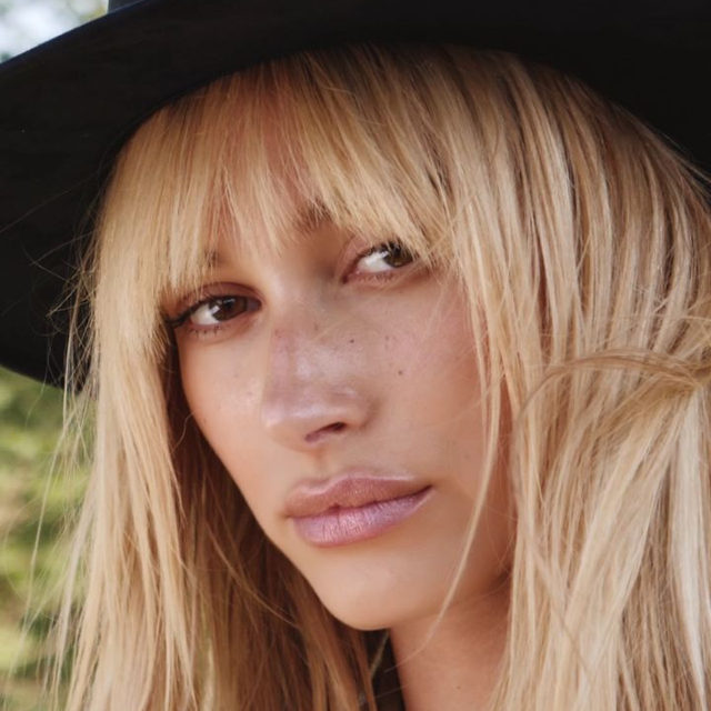 Despite #HaileyBieber and her family being part of the fabric of the West Coast, she grew up away from the dazzle of Hollywood, surrounded by the natural beauty of New York's Hudson Highlands. For the October issue of #BritishVogue, the model returned to the mountains near her childhood home to capture autumn's bohemian spirit in prairie dresses, sturdy boots, and homespun knits. Click the link in bio to watch the full film.  Directed by @MattEaston, styled by @DenaGia and videography by @RuslanPelykh, with hair by @PanosPHair, make-up by @TheRealOfficialFrankB, nails by @LollyKoonNails, props by @AliceMartinellli and production by @HHellon.