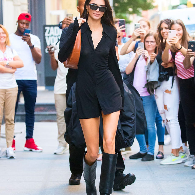 There's a new boot trend in town. Every fashion girl in New York has been styling knee-high boots to perfection this week. Tap our link to get in on the cool fall trend. photo: getty images