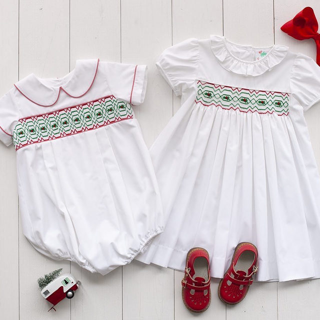 Crisp white, hand smocked, and ready for the holidays! 🎄🎅🎁