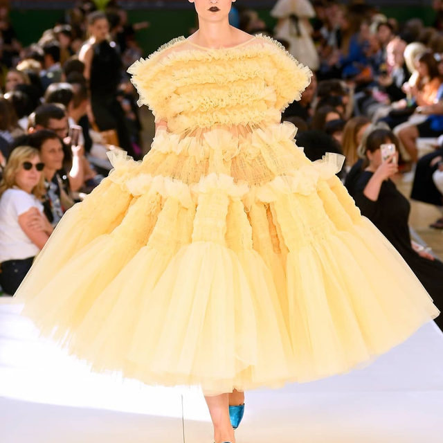 """Straightforward and simple,"" is how #MollyGoddard described her 5th anniversary #SS20 show at #LFW, despite the frills and flounces and hundreds of metres of tulle. This season, the British designer explored new ways of incorporating volume into her remarkable pieces with clever pin-tucked dresses that ballooned around the body, frilled godets exploding open skirts and corseted denim and figure-hugging ruching. Click the link in bio to read the review and to see every look from the catwalk."
