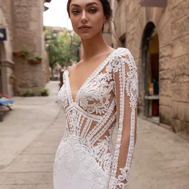 Geometrical cuts of lace shape the artful bodice of the this stunning dress. Discover the Pasiphae gown at your nearest store. #Pronovias2020