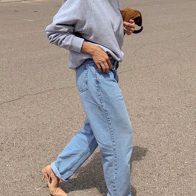 """Grandpa jeans—they're somewhere between """"mom"""" jeans and a baggy fit, and we're fully obsessed. Tap our link to get in on the potent denim trend you're about to see everyone wearing. #HighlyDocumented photos: @filis_pina, @stefneyv, @honeybelleworld"""