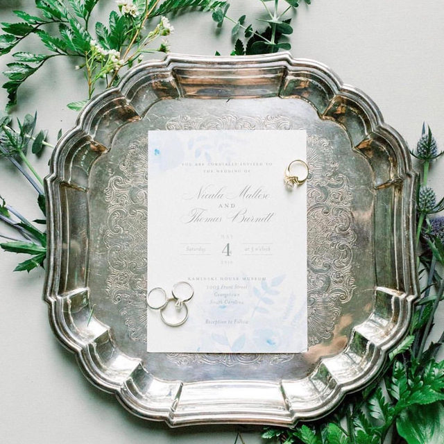 "Living for the greenery details in this beautiful flatlay featuring""Watercolor Floral"" wedding invitation by @jillmeansdesign. 🌿 — #MintedWeddingPlanner @katiewilliamsevents 
