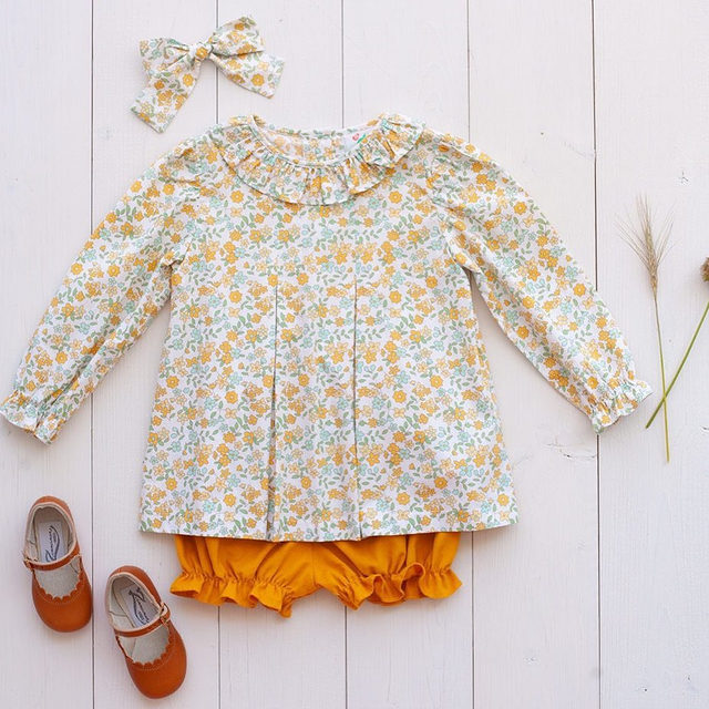 The cutest little outfit we ever did see 😍 This beautiful floral top can be paired with cord bloomers or pants for winter, and shorts for spring. The perfect little transitional top!