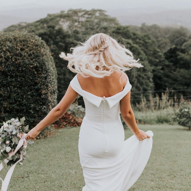 The powerful simplicity of crepe is enough to outline a feminine figure. #PronoviasBrides Nikkita wearing the Crystal dress. Photographer: @mallorysparklesphoto