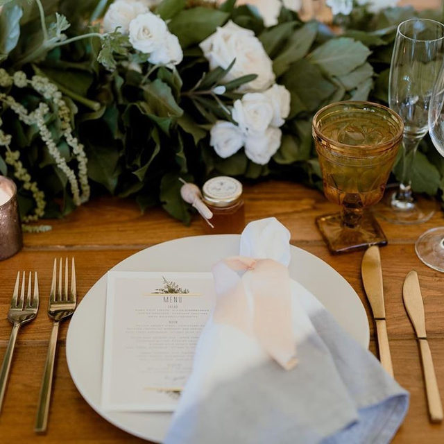 "The perfect rustic touches to this wedding reception featuring ""Diamante"" foil-pressed menu design @leahbischstudio. ✨ — #MintedWeddingPlanner @amychampagneevents 