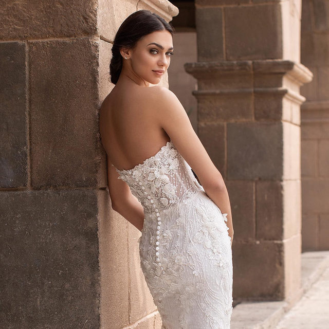 Aethra:  a breathtaking mermaid gown that comes to life in glittering, three-dimensional flowers. Discover it at your nearest store. #Pronovias2020