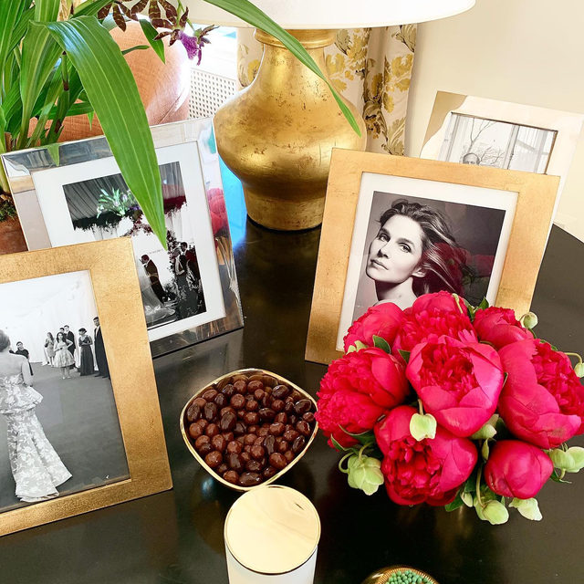 Table full of memories, fresh flowers and AERIN home items...