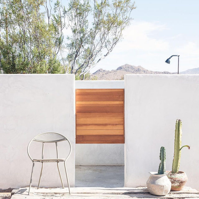 "Anyone else adding ""outdoor shower"" to their holiday wishlist? 💭 📜 We're using this one from the desert home of @wondervalley owners @alaalison and @onetrippass as inspo 🚿🌵 See more of their super creative space 👉 link in bio 📸 by @timhirschmann ✍️ by @corynnestudio"