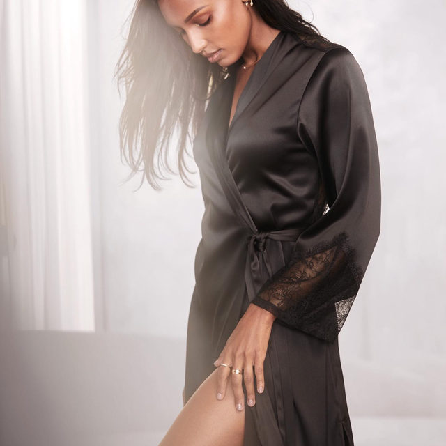 This gorgeous satin robe has a sheer Chantilly lace back. You'll just have to take our word for it.