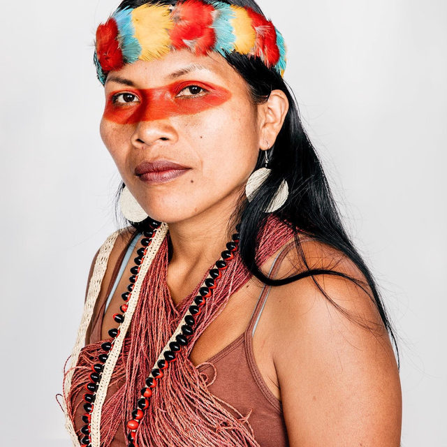 """This summer, fires began to rage in the Amazon—known as the """"planet's lungs"""" and responsible for producing 20% of the oxygen in the earth's atmosphere—as a direct result of Brazilian president Jair Bolsonaro's weakening of environmental protections, which set the scene for mass deforestation. This thrust into the spotlight the work of a group of indigenous leaders from the Waorani, Kofan, and Siona nations in the Ecuadorian and Colombian Amazon, who have come together with Amazon Frontlines to give voice to their shared work of protecting their regions' natural resources, such as Nemonte Nenquimo, pictured above.  Nenquimo is the first female leader of CONCONAWEP (Waorani Organization of Pastaza Province) and lead plaintiff in the Waorani's people's recent landmark lawsuit protecting half a million acres of their rainforest territory from oil drilling. Facing danger each day she fights for these causes, Nenquimo explains, """"People who are part of this fight are being threatened by the government. They want to"""