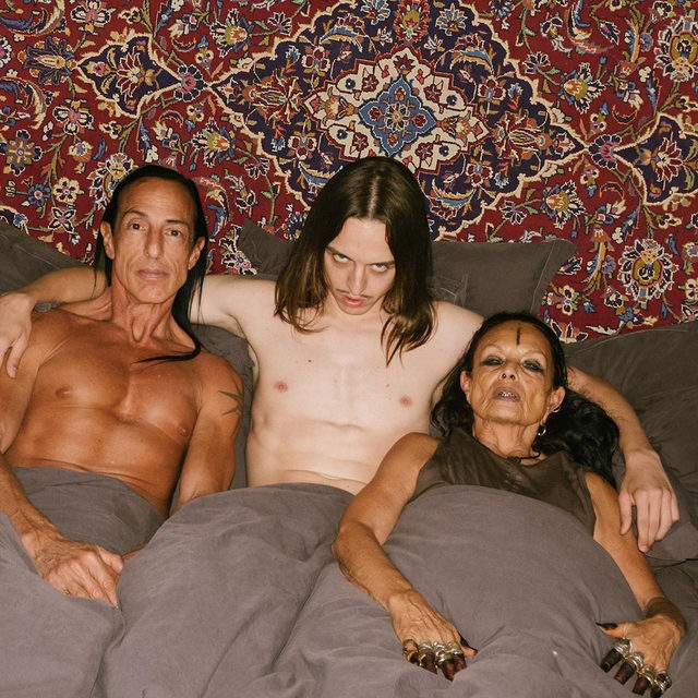 @TommyCashworld and his pencil-thin mustache's latest Instagram share capture the Estonian rapper in bed with none other than designer @RickOwensonline and his partner Michèle Lamy (@lalamichmich). And though Cash has previously created bizarre Instagram scenario shares—like photoshopping himself into a dress made to look like a giant Croc clog—this moment happened IRL at Owens's Paris apartment right before the designer's performance at the Centre Pompidou for the @FIACparis International Contemporary Art Fair. Tap the link in our bio for more details on the deliciously weird social share. Photo by @shadrinsky