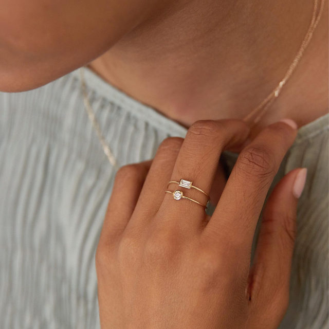 """The rings. I love how classic they look from the top view and then the sides are so open and unexpected with a little bit of an edge. It's like a little secret just for the person who's wearing it."" – Khadijah, our Jewelry Designer on why our @DiamondFoundry created Diamond Bezel Rings are her favorite design."
