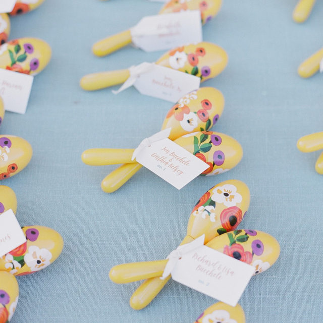 Super cute favor idea 💛🌸🐋 Who wouldn't want to receive a pair of these amazing hand-painted maracas? And we just love that yellow on top of our #tuscanylinen in Ice 😍 From a #rehearsaldinner by @toastsantabarbara at @sbhistoricalmuseum 📷 @tenthandgrace With @losarroyosrestaurant @brighteventrentals @casadeperrin @theonicollection @bellavistadesigns #latavolalinen #transformyourtable #weddingfavor #weddingfavoridea #yellowandblue #maracas #handpainted #colorfulwedding #weddingideas #linen #linenlife #naturallinen #santabarbara #santabarbarawedding #gettingmarried #colorcombo