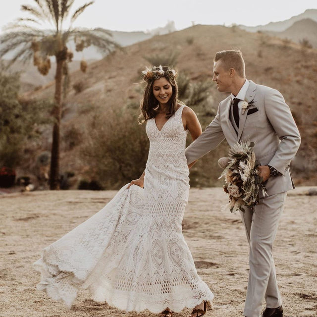 Bohemian romance.❣️ (Tap to shop the Peoria Gown | 📷: @wearemattandjess 💑: @roxysommers + @topher_sommers 💐: @arrangements_design)
