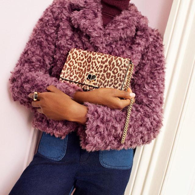 """are you wearing the--"" ""nicola metallic leopard chain wallet? yeah i am."" #katespade #loveinspades"
