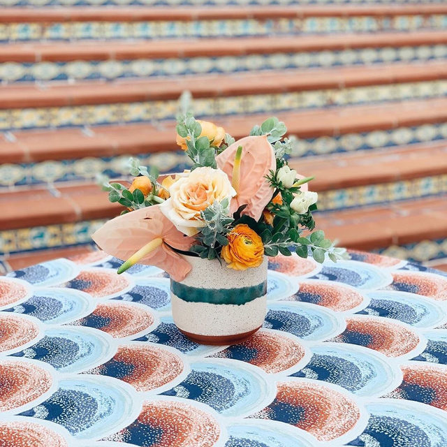 Pattern play all day 😍🧡🔥 featuring the stunning #hearstcastle Spanish tiles and our #kennedylinen in Rust. Florals by @adornments_flowers with  @hearstcastlepf @alisonmazzolacomms @sidecar_slo @brighteventrentals @kramerevents #latavolalinen #transformyourtable #patternplay #cocktailhour #spanishstyle #centralcoastcalifornia