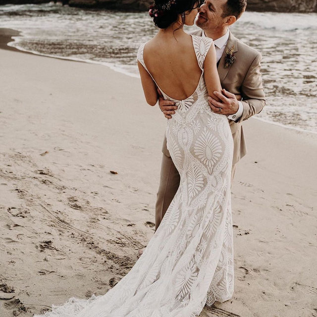 As endless as the oceans, as timeless as the tides. (Tap to shop the Ludlow Gown | #BHLDNBride @navthejourn 📷: @purpleashphoto)