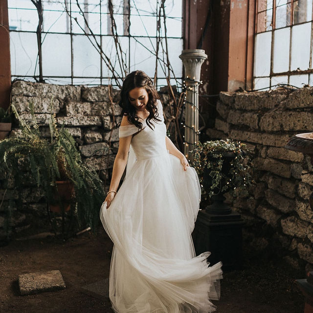 Ethereal tulle, off the shoulder elegance, and a dreamy silhouette. (Tap to shop the Jillian Gown | 📷: @beginningandendphoto 👰:@mackenzie_orchard 💄:@hollytippmakeup)