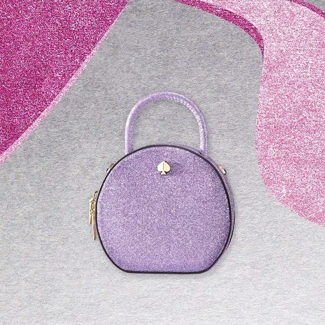 what to get someone who's well rounded 💜 (it's our andi glitter canteen bag.) #katespade #loveinspades