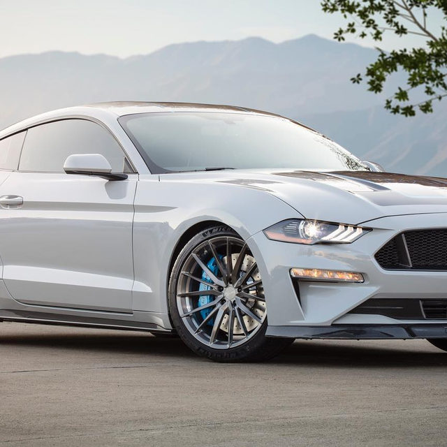 """Ford built a bonkers 900-horsepower electric Mustang with a six-speed manual for SEMA. It's called the Mustang Lithium, and it's packing 1000 lb-ft of torque coming from an 800-volt electric system. The wheels are 20-inch items made by Forgeline, wrapped in Michelin Pilot Sport 4S tires. It even has a """"Beast"""" drive mode. Would you take it over a gas-powered V-8-powered Mustang GT?"""
