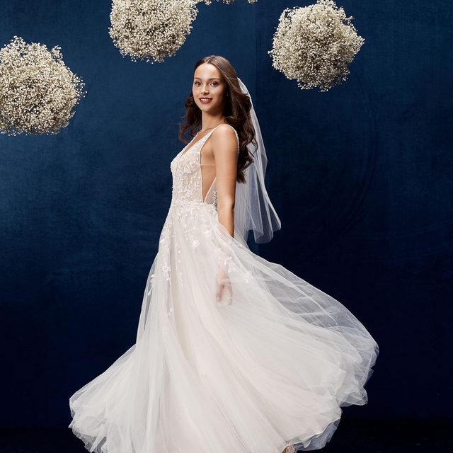 A ballgown that's lighter than air — and flowers to match. (Tap to shop the Seeley Gown)