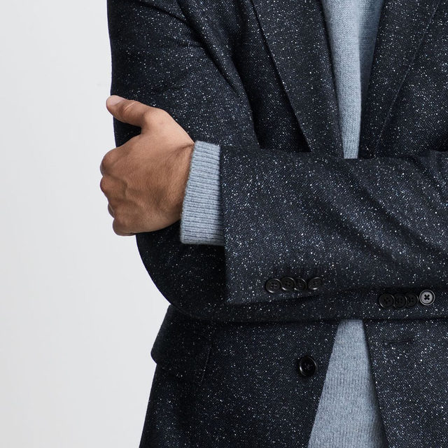 It's all in the details—our Slim Herringbone Blazer is woven with a specially developed yarn with a unique, speckled appearance that creates a galaxy-like, spacedye effect.