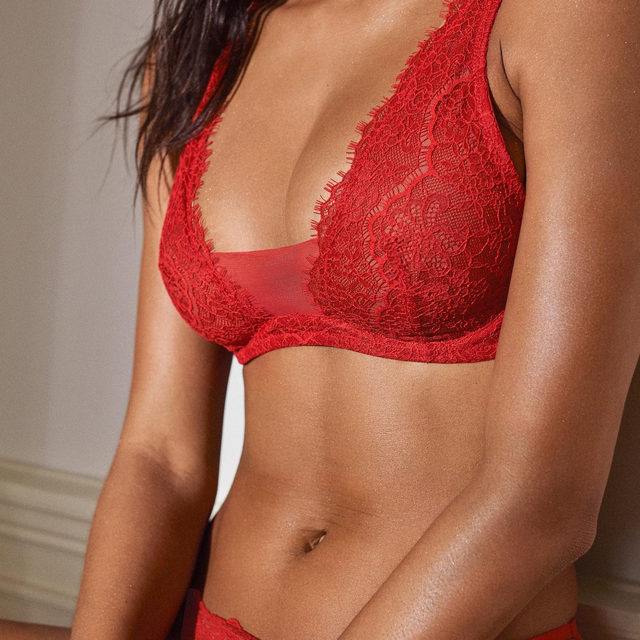 Unlined—and undeniably sensual—in romantic rouge lace.