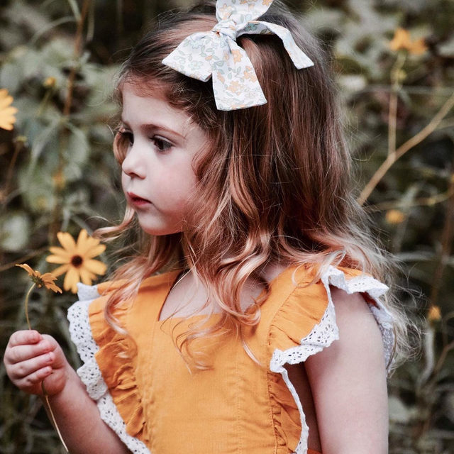 In a field full of roses she is a wildflower 🌼 Our most popular Dover Jumper is on sale for $34.85, sizes 2t-7 (shop the link in our profile). 📷: @jennjarrell | @caittlinallene
