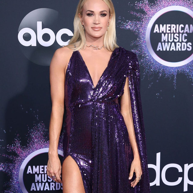 Country queen 👑 @carrieunderwood wore what else but sequins and the color of royalty. Link in bio for all the best looks from tonight's #AMAs red carpet.