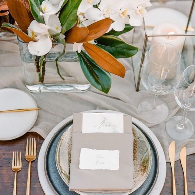 Pure elegance with our #auroralinen table runner in Sand and #topazlinen napkins in Ash ✨✨✨ Loving all the different textures and metallics...and those magnolia leaves! Amazing job @rmbocollective @megan_gray 🙌 Photo @rebeccayale featured on @stylemepretty With @ritzcarltonbacarasb @theark_ @copperwillowps @thewellsmakery #latavolalinen #transformyourtable #magnolialeaves #sheertablerunner #santabarbara #santabarbarawedding #neutralcolors #metallics #tablesetting #modernwedding #modernbride #texture