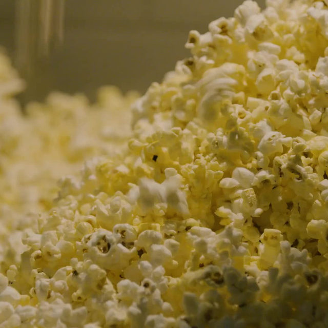 "Popcorn has been a quintessential part of the American movie-theatre experience for decades. ""They get you as soon as you walk in the door. It's the smell,"" one moviegoer said. To achieve the signature taste-bud-assailing butter flavor, cinemas use a product called Flavacol, a sandlike substance whose only resemblance to dairy is its paper-carton packaging. Flavacol is cheaper and easier to manipulate than real butter and the sodium content is stunning: in one teaspoon, there's more than 100 per cent of the recommended daily amount. At the link in our bio, read more about popcorn's multisensory appeal. Produced by @lydiacornett and @vivianefeldman."