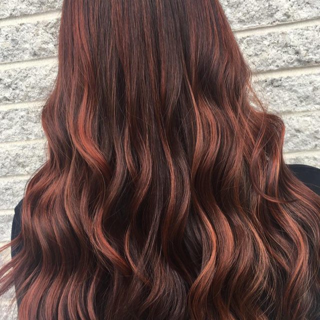 "New hair color trend alert: ""Raspberry bourbon"" is the new way to add rich red highlights to brown hair. Link in bio for more details and inspiration. #regram #hair by @hairby.erikarohrbach"