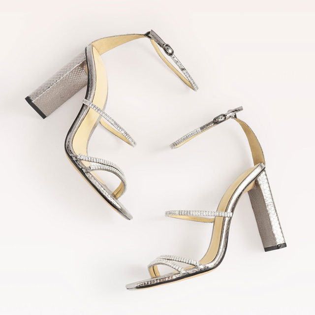 Meet the Lacy sandal. This soaring elegant silhouette that  shines in metallic snakeskin.  #AlexandreBirman #sandalssouthcoast