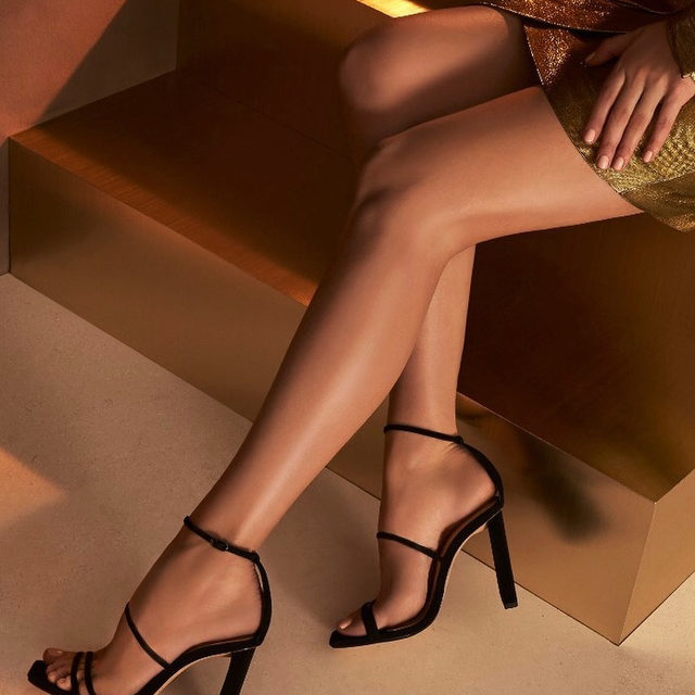 An elegant and effortless holiday must-have style, the Lacy sandal featuring a sculptural heel and barely-there straps. #AlexandreBirman #Sandals