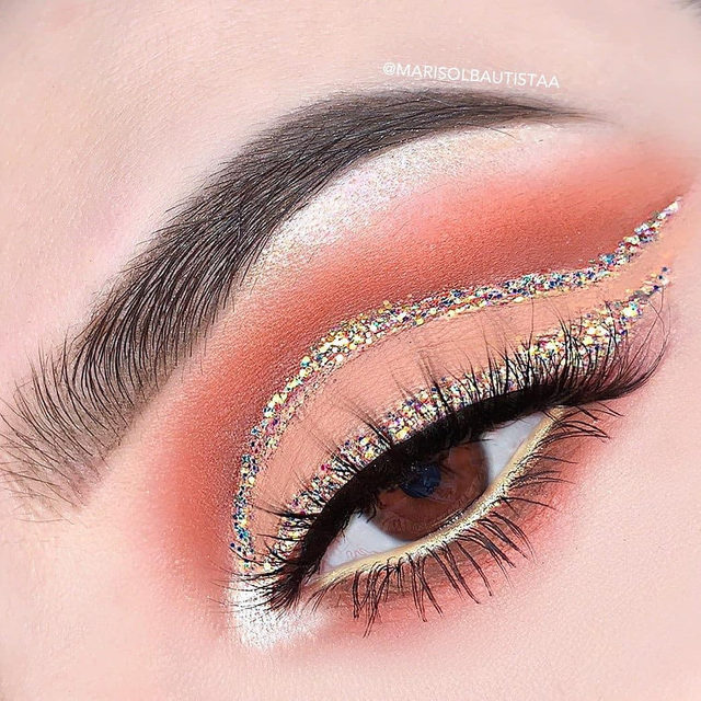 When in doubt, glitter it out (Or lash it out) 😘❤️  ✨ @marisolbautistaa is getting us in our festive spirits with this gorgeous multicoloured gold liner and cut-crease. She paired this look up with our Fluff'n Glam lashes in the style IDGAF! ✨  🚨 Have you shopped our 12 Days of Velour yet? Use the code 𝐇𝐎𝐋𝐈𝐘𝐀𝐘 to receive 40% off all Holiday Kits; this deal applies to our Naughty But Nice Kit, Let's Have A Ball Kit, Velour Lash Vanity and Velour Lash Book! 🚨  Hurry because this offer ends December 9th at 11:59 AM EST 🤗  #VelourLashes #LiveInLashes #VelourBeauty #12DaysOfVelour
