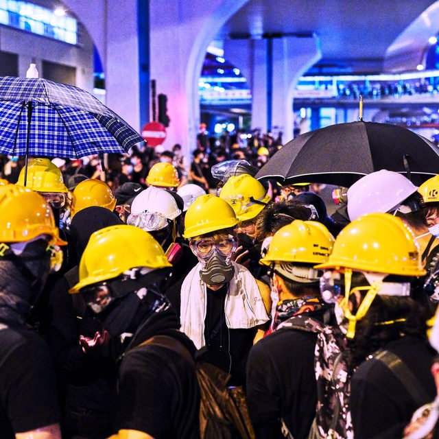 "In Hong Kong, all-black clothing, gas masks, and helmets have become the de-facto uniform of the uprising that has convulsed the territory over the past six months. Since June, an estimated 1.7 million people—around 20 per cent of the population—have marched in protests against Beijing's influence. The previous large-scale protest movement, in 2014, was characterized by nonviolence. That is not the case today. ""Tear gas was misting around the crowd in great gray plumes,"" Jiayang Fan writes of a demonstration she witnessed. ""The protesters hurled bricks and a few Molotov cocktails at the police. Lines of flame flashed on the street. . . . At one point, a tear-gas cannister landed by my feet, unleashing a furious itch across my body."" At the link in our bio, read Fan on the origins and potential outcomes of protests that have gripped Hong Kong. Photograph by @anrizzy for The New Yorker."