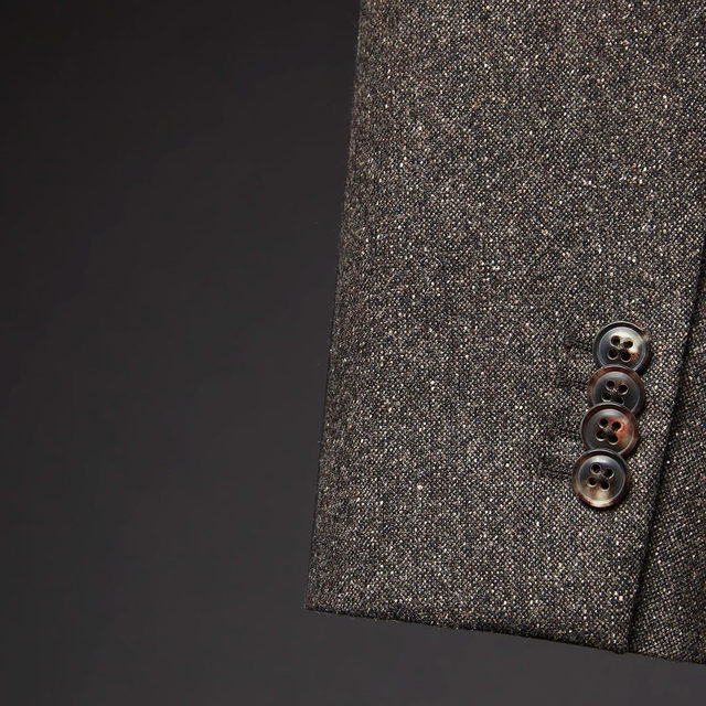 We craft our suits with high-quality details inspired by Savile Row.