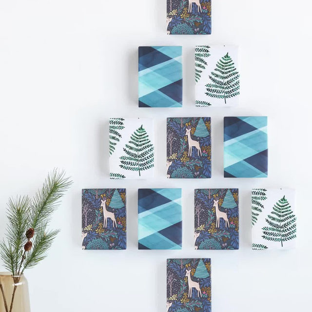 """We're counting down the days. The clock is ticking to get them the most thoughtful gifts they'll receive. Link in bio for our holiday delivery deadlines. #MintedHoliday — """"Silver Fir"""" by lemonbirchdesign + """"Philadelphia"""" foil-pressed map Alex Elko Design."""