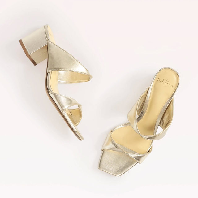 The Miki is a modern, versatile mule in metallic leather, featuring a block heel and square-toe silhouette. #AlexandreBirman #Mules